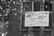 Baner na Domu Spotkań przy ulicy Żydowskiej 15a